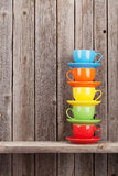 Colorful coffee cups on shelf Stock Photography