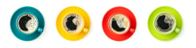 Colorful coffee cups on a white background Stock Images
