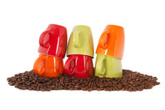 Colorful coffee mugs with beans Stock Image