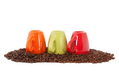 Colorful coffee mugs with beans Stock Photo