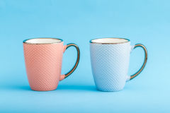 Colorful Coffee Mugs on Blue Background Stock Image