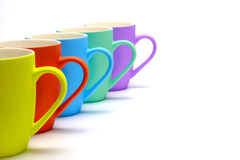 Coffee mugs. Colorful coffee mugs isolated on white background royalty free stock image