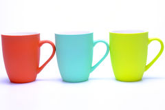 Coffee mugs. Colorful coffee mugs isolated on white background royalty free stock photography