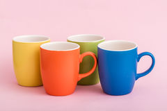 Colorful Coffee Mugs on Pink Background Stock Image