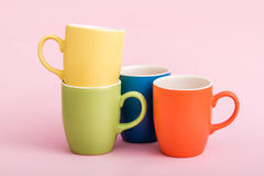 Colorful Coffee Mugs on Pink Background Royalty Free Stock Photo