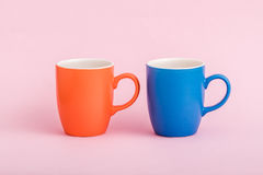 Colorful Coffee Mugs on Pink Background Stock Photos