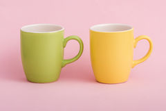 Colorful Coffee Mugs on Pink Background Royalty Free Stock Photos