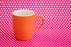 Colorful Coffee Mugs on Pink Background with White Dots Royalty Free Stock Photography