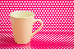 Colorful Coffee Mugs on Pink Background with White Dots Royalty Free Stock Photos