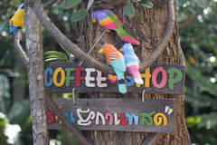 Colorful coffee sign. And birds Royalty Free Stock Photos