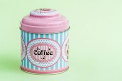 Colorful Coffee, Tea, Sugar Tin Storage Containers. On green Stock Photography