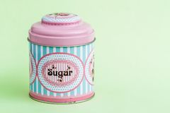Colorful Coffee, Tea, Sugar Tin Storage Containers. On green Stock Images