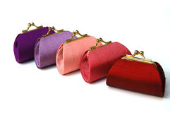 Colorful coin silk purses Royalty Free Stock Images