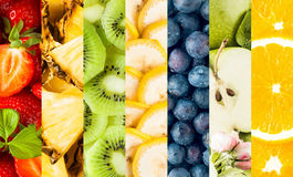 Colorful collage of assorted tropical fruit. With vertical bands displaying strawberries, pineapple, banana, blueberries, apple and oranges for a food royalty free stock image