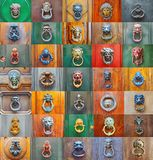 Colorful collage of a variety of knockers and handles on ancient  doors. In Rome, Italy Royalty Free Stock Image