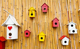 Colorful collection of birdhouses. On wood wall Stock Images