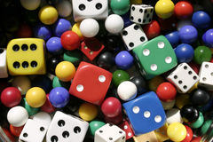 Colorful collection of dice and marbles. A collection of newer and vintage dice and marbles for games.  Very colorful assortment Royalty Free Stock Image