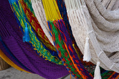 Colorful Collection of Hammocks. Colorful group of hammocks, woven of different bright colors. For sale at the French Market in New Orleans Royalty Free Stock Photos
