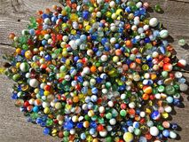 Colorful collection of marbles. A huge collection of colorful marbles lay on a floor royalty free stock photo