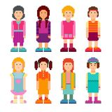 Colorful collection of pixel art female characters. Women standing on white background. Vector illustration Royalty Free Stock Image