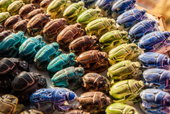 Colorful Collection of Scarab Beetles in Egypt. Colorful representation of a beetle from the Scarab family. Egyptians believe it brings luck and acts like a Stock Photo