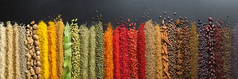Colorful collection spices and herbs on background black table. Mediterranean condiments for decorating packing with food. Spices and herbs for website headers royalty free stock image
