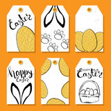 Colorful collection of tags and labels for Easter with Easter eggs and rabbit ears . Wishes for a happy Easter. Print. Vector. Colorful collection of tags and Stock Image