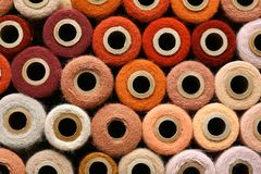 Colorful Collection of Vintage Spools of Craft Yarn Royalty Free Stock Images