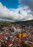 Colorful colonial crowd American city and church in hill, Guanajuato, Mexico stock photography
