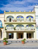 Colorful colonial building in Havana. With distinct traditional architecture elements such as porticoes,balconies and colorful stained glass windows and doors royalty free stock photos