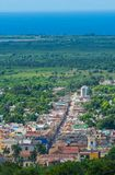 Colorful Colonial Caribbean street overlook with classic building and house, Trinidad, Cuba, America. stock photo
