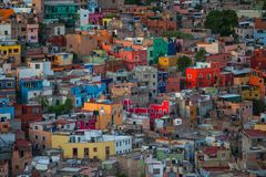 Colorful colonial crowd American city and buildings in hill, Guanajuato, Mexico royalty free stock photography
