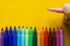 Colorful of color pen isolated with yellow background royalty free stock photo