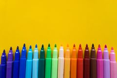 Colorful of color pen isolated with yellow background stock photography