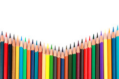Colorful color pencil arranged in diagonal line on white background royalty free stock photography