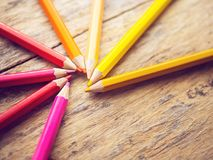 Colorful color pencils on old wooden table with copy space Royalty Free Stock Image