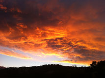 Colorful Colorado Clouds. Fire in the sky in the Saguache Mountain range in Colorado Stock Images