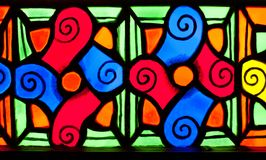Colorful colorful glass in the church. Colorful glass, colorful, colorful designs in the church fair JFS Stock Image