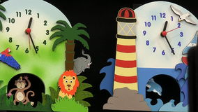 Colorful colourful children clocks stock video