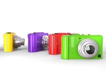 Colorful compact digital photo camera. Royalty Free Stock Image