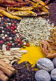 Colorful composition with different herbs. Variety of spices: nutmeg, cardamom, mustard seeds, pepper, cinnamon, dried chili's, fennel seeds Stock Photo
