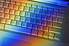 Colorful Computer Keyboard. A computer keyboard with a rainbow spectrum of light Stock Photo