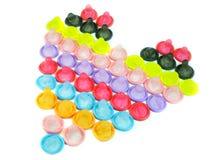 Colorful condom. Arrange heart shape, isolated background Stock Photo