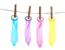 Colorful condoms on a clothespins. Colorful condoms with clothespins on a rope Royalty Free Stock Photography