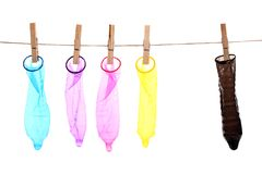 Colorful condoms on a clothespins Stock Image