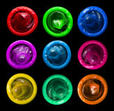 Colorful condoms. Isolated on black background Royalty Free Stock Photo