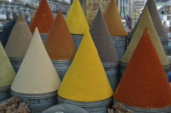 Colorful cones of spices. Colorful spice cones in traditional shop or market Stock Photos