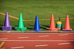 Colorful cones on a sports track Royalty Free Stock Photography