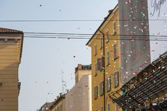 Colorful Confetti in City Street among Buildings. Colorful Confetti in the Air in City Street among Buildings Stock Images