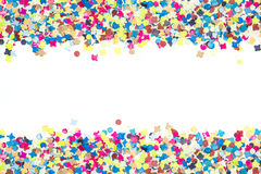 Colorful confetti in broad bordure Stock Images